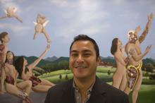 Carlos Cabrera med student and mural