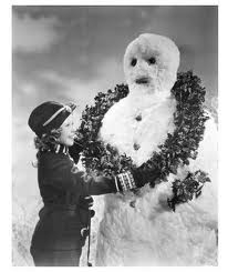 Shirley Temple decorating snowman