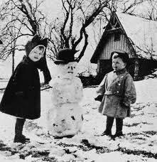 2 girls build snowman 1930